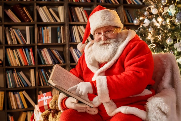 Picture of Santa Claus reading in his library