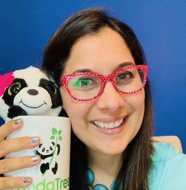 Spanish Tutor Ana poses with a panda